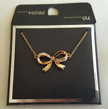"GOLD TONE BOW NECKLACE WITH 9 FAUX CRYSTALS ON 16""-19"" CHAIN, BRAND NEW IN PACK"
