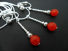 A SILVER PLATED FACETED RED JADE BEAD NECKLACE AND CLIP ON EARRING SET. NEW.