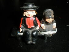 Vintage Cast Iron Amish sitting on Bench