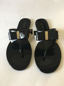 NWOB MICHAEL KORS KAYDEN JELLY THONG SANDAL W/BOW GOLD & BLACK SIZE 10