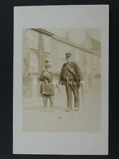 Postman with Walking Stick Delivers Mail with support from boy c1905 RP Postcard