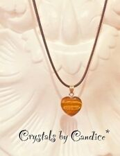 Heart shaped natural tigers eye gemstone pendant on 18 inch waxed cotton chain