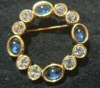 M&S,Mark's & Spencer gold tone circular brooch clear & blue Rhinestone signed