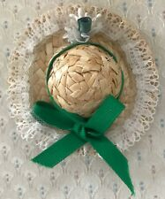 A Potpourri Filled Sachet made from a Tiny Straw Hat w/Lace & Green Ribbon.