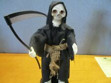 Grim Reaper that moves & eyes that glow, Needs batteries but still works