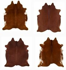 LG/XL Brazilian Solid Brown cowhide rugs. Measures approxi, 42.5-50 square feet