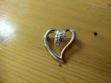 Heart Shaped Golden Brooch With Three Stones