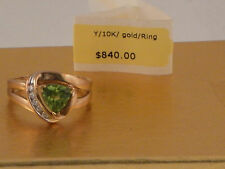 Beautiful solid 10kt gold  genuine  peridot  and diamond ring