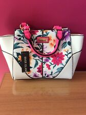 small white river island bag with floral panel and pink handles