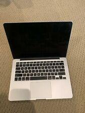 Early 2015 Macbook Pro 13 inch Silver - 256 GB hard drive w/ i5 core.