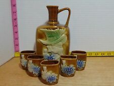 New listing Brown Pottery Sake Alcohol Decanter With 5 Cups Woman In Hat Floral