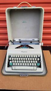 Vintage OLYMPIA Deluxe Werke AG Portable Manual Typewriter  Made in West Germany