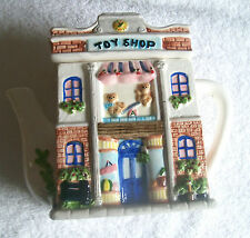 CERAMIC TEA SERVER/COOKIE JAR ,BRIGHT AND COLORFUL, SAYS TOY SHOP