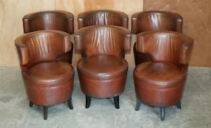 FOR RESTORATION! SUITE OF 6 VERY COMFORTABLE AGED BROWN LEATHER TUB ARMCHAIRS