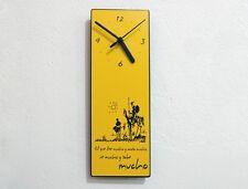 Don Quixote Quote Ve mucho y sabe mucho - Wall Clock
