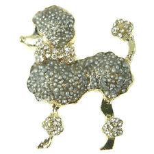 Broche chien caniche gris argenté métal doré cristal collier noeud papillon