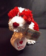 PLUSH RED AND WHITE DOG 10 IN LONG WITH PLASTIC CONTAINER ANIMAL ALLEY