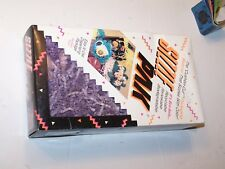 Full 10 X 5 1/2 X 2 1/2 package cushion cut 1993 Sizzle Pak Purple confetti