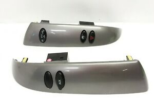 05 06 Toyota Sienna front Radio Climate Control Side Trim Panel Set Pair Switch