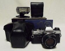 OLYMPUS OM10 35mm SLR Film Camera w/50mm Lens, Case, T-20 Flash, Manuals & Box