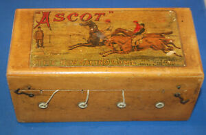 "An ""Ascot"" horse racing game, metal horses, winding mechanism, decorative box"