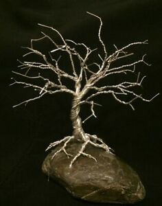 Wire Tree Of Life Sculpture on rock