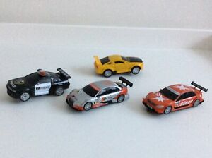 SCX Compact 1/43 Extreme Raiders Slot Cars plus Two Others.  4 in All