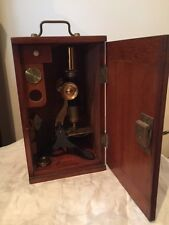 Brass Microscope circa. 1880s in box with key and a small set of original slides