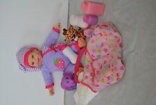 Baby Doll Wearing Purple Pajamas Says Momma