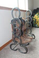 Horseshoe boot rack holds 2 pair