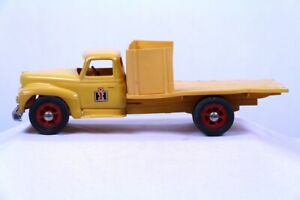 International Harvester  Product Miniature Co. plastic yellow IH truck w/stakes