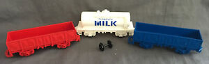 3 Plastic train carts ( Tidmouth milk, blue cart & red cart)