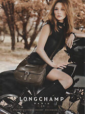 Publicité 2011  //   sac à main LONGCHAMP  PARIS  pret à porter et accessoires