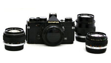 Olympus OM-1n Black with 28mm/2.8, 50mm/1.4 and 100mm/2.8 Zuiko Lenses