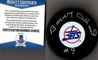 BECKETT-BAS BOBBY HULL #9 AUTOGRAPHED-SIGNED WINNIPEG JETS HOCKEY PUCK H19652