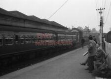 PHOTO  SUBURBAN SET AT FALKIRK (GRAHAMSTON) STATION SC59557 IS PART OF CONSIST.