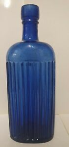 OVAL BLUE GLASS RIBBED POISON BOTTLE