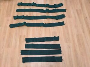 Upholstery webbing elasticated green. Cut into strips. Four X 56, four x100 cm