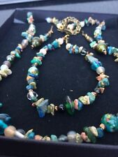 Beautiful green-coloured jewellry set. Handmade, bronze accents including charms
