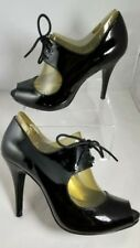 Guess woman shoes 100% Authentic size 8 patent leather black ultra modern look!