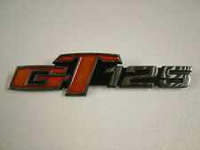 SUZUKI GT125 K-B, '73 - '77  SIDE COVER BADGE, NEW CAST REPRODUCTION.