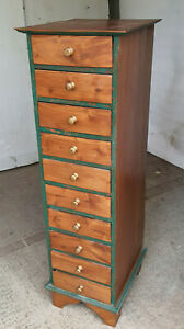 tall,narrow,painted,hard wood,chest of drawers,10 drawers,knob handles,drawers