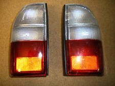 fanale faro posteriore dx e sx mitsubishi L200 2001>2005 prezzo coppia