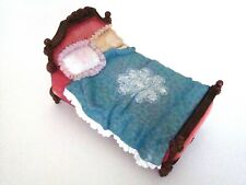 Resin Bed Made up with White Ruffle Blue Bead Spread and Pretty Pillows