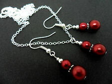 A DARK  RED GLASS PEARL   NECKLACE AND EARRING SET. NEW.