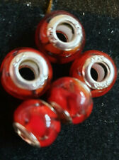 5 RED WITH BLACK PATTERN BEADS