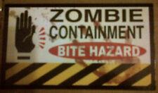"""ZOMBIE """"ZOMBIE CONTAINMENT - BITE HAZARD"""" VINYL REFRIGERATOR MAGNET 2013"""