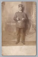 Train Ticket Taker RPPC Railroad Occupation—Studio Occupation Photo 1910s