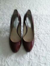 Michael kors heels size 10. Color: Burgundy.