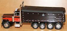 1/64 DCP BLACK W/ RED SEMINOLE PAINT 379 PETERBILT W/ BLACK MAC DUMP BOX